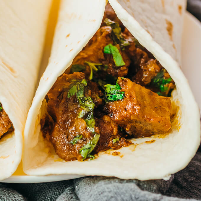 serving saucy roasted pork in a low carb tortilla wrap