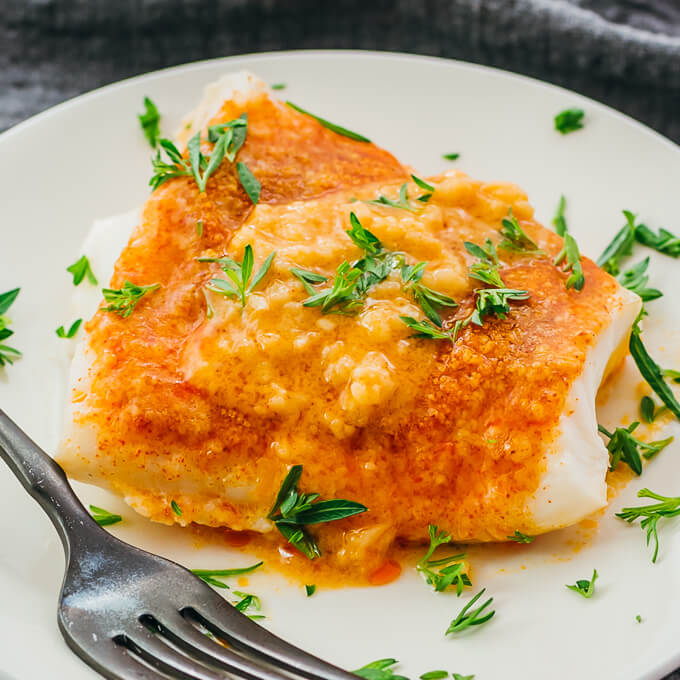 closeup view of baked cod on plate