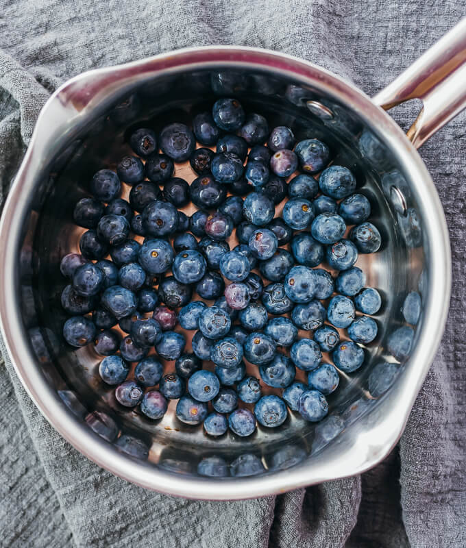 fresh blueberries added to a saucepan