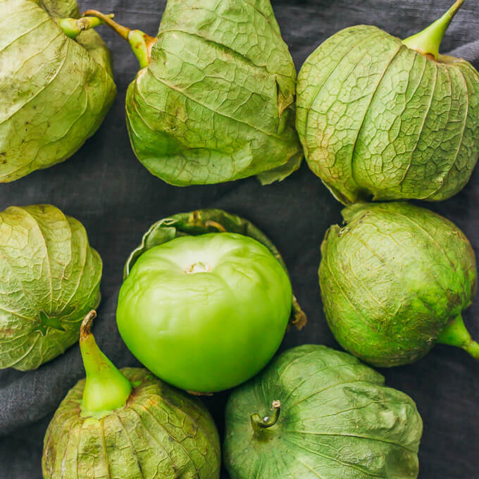 Removing the husks from tomatillos