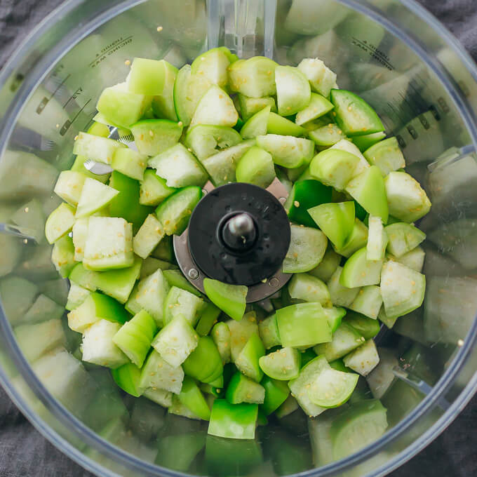 chopped tomatillos in food processor