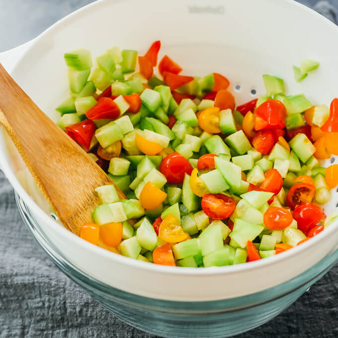 salting cucumbers and tomatoes in colander