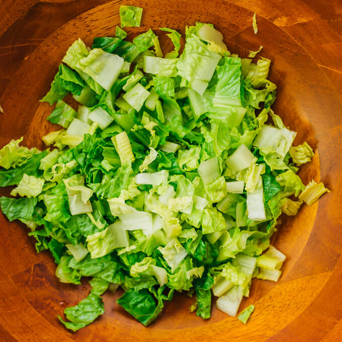 romaine lettuce in wooden bowl