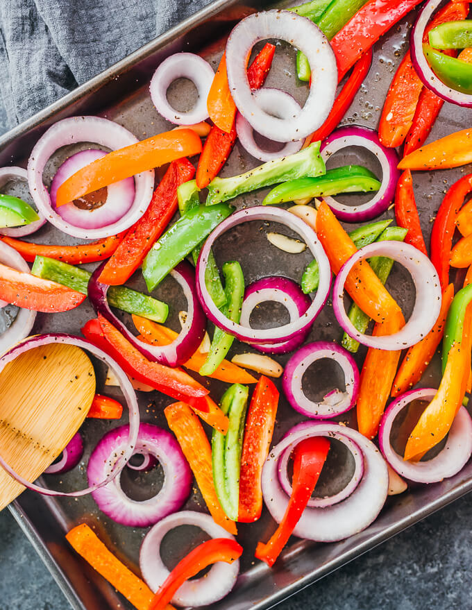 mixing bell peppers and onions with seasonings