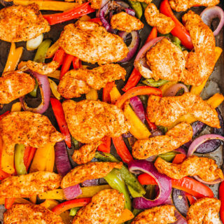 chicken fajitas on a baking sheet after baking