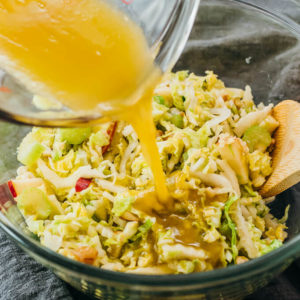sherry vinaigrette poured over a cabbage salad