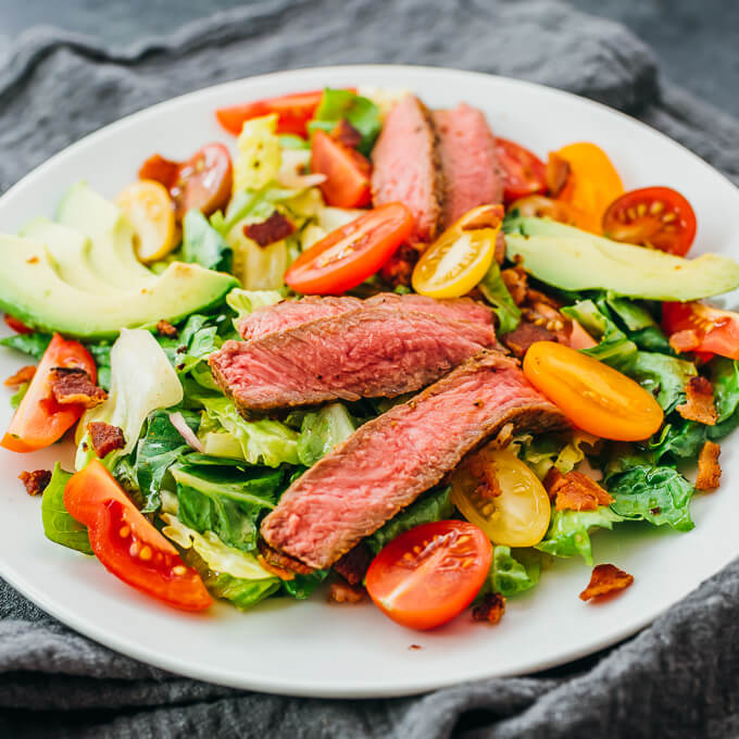 steak salad served on white plate