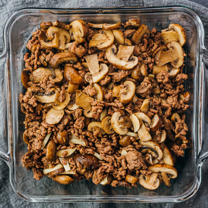 mushrooms and beef in casserole dish