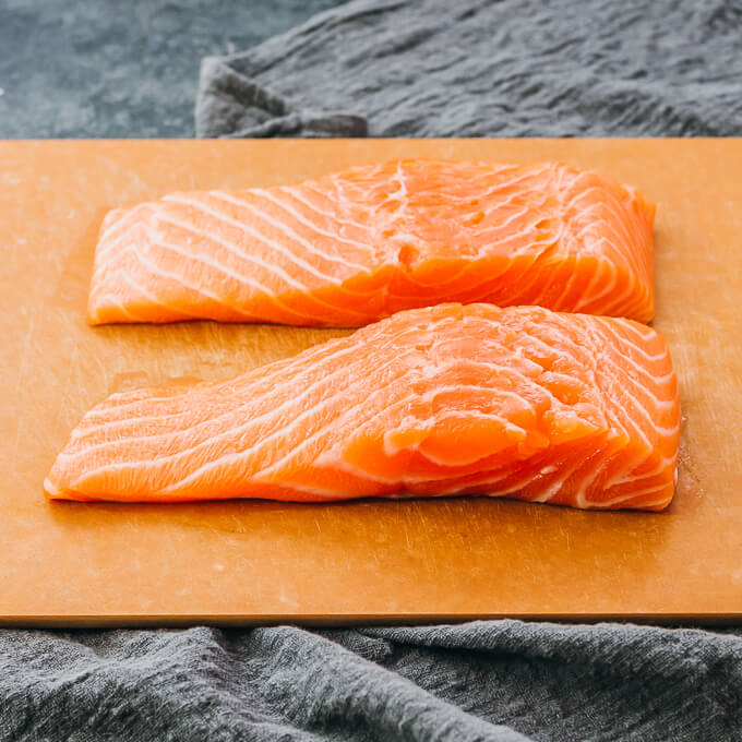raw fresh salmon fillets on a cutting board