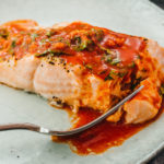 flaky tender salmon on a plate