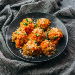 meatballs with sauce on black plate