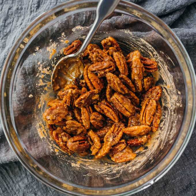 coating pecans with sweet cinnamon mixture