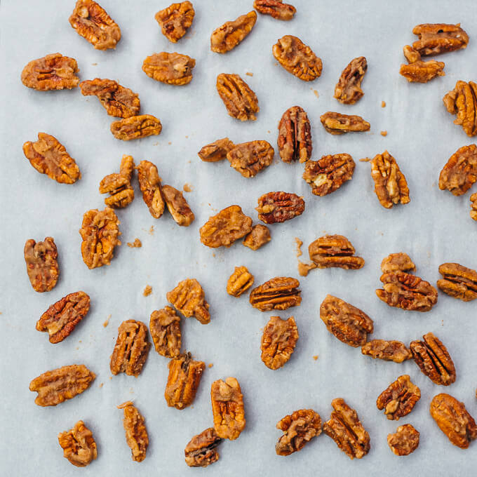 spreading out pecans on baking sheet