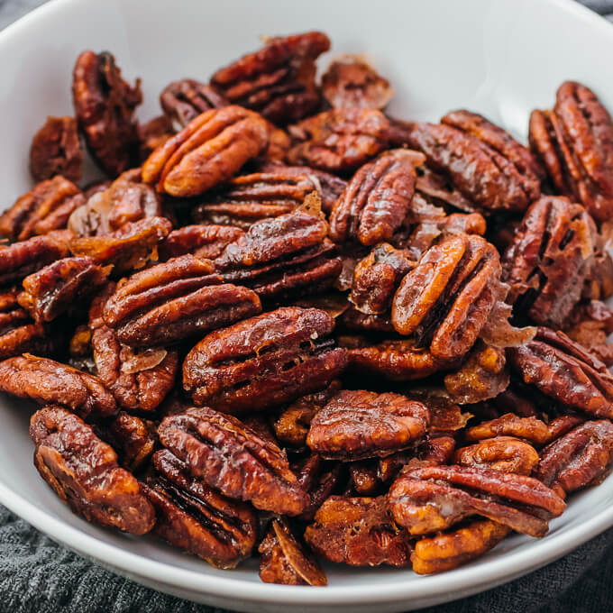 candied pecans in white bowl