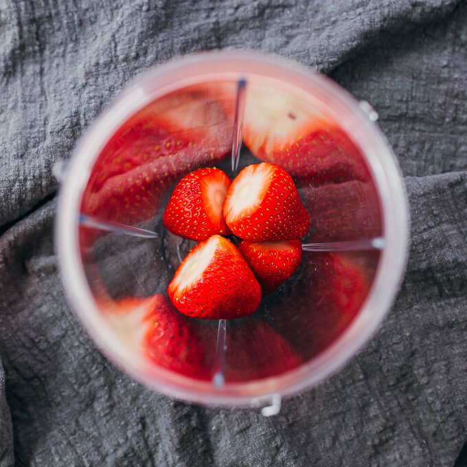 fresh strawberries in blender cup