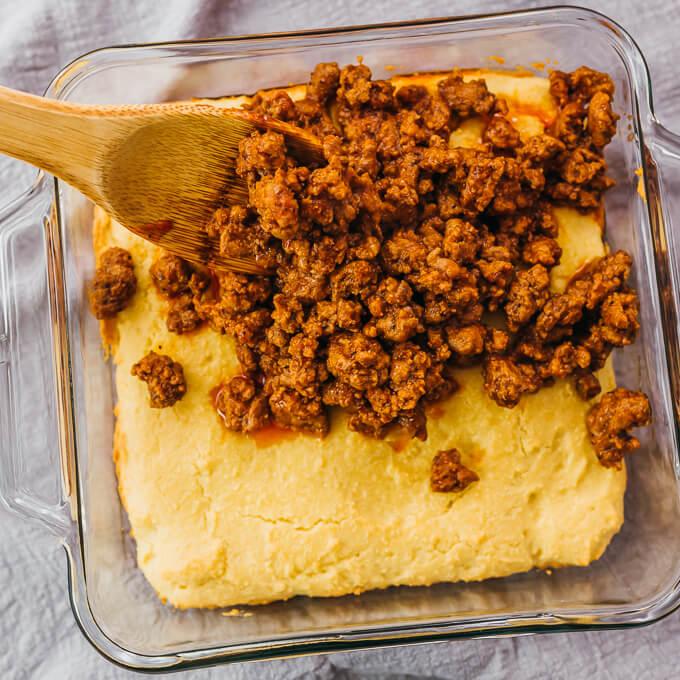 sloppy joes spread over cornbread