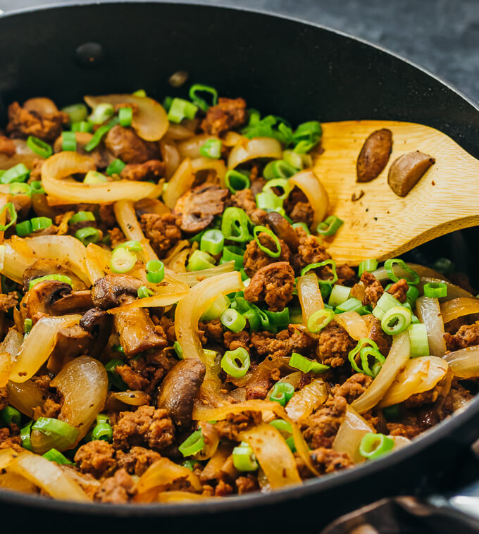 stirring ground beef stir fry in pan