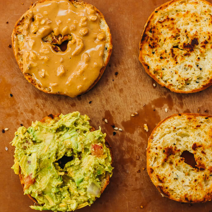 keto bagels spread with guacamole and peanut butter