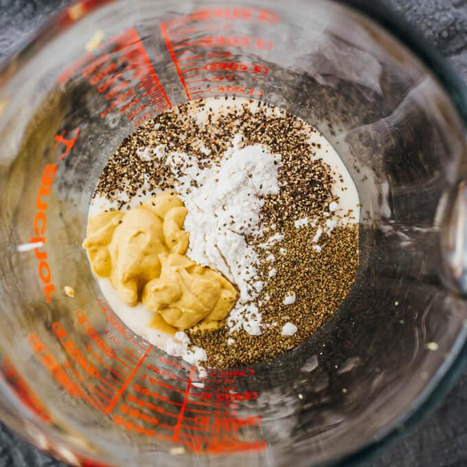 keto coleslaw dressing ingredients in measuring glass
