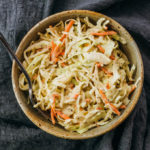 overhead view of keto coleslaw served in stoneware bowl