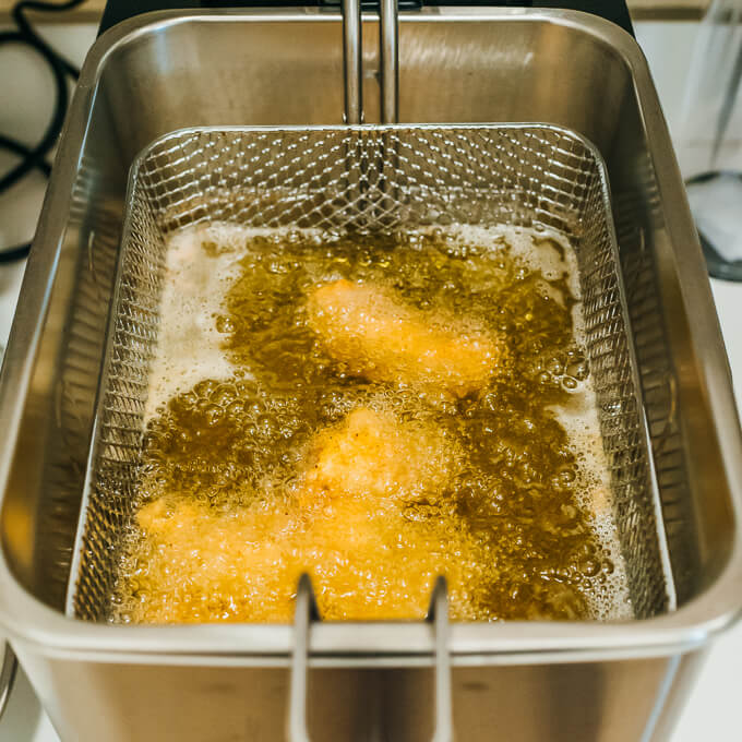 cooking fried chicken in deep fryer