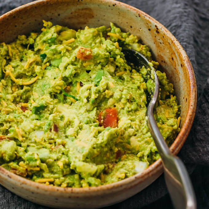 close up view of guacamole served in stoneware bowl
