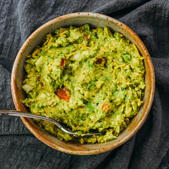 overhead view of guacamole served in stoneware bowl