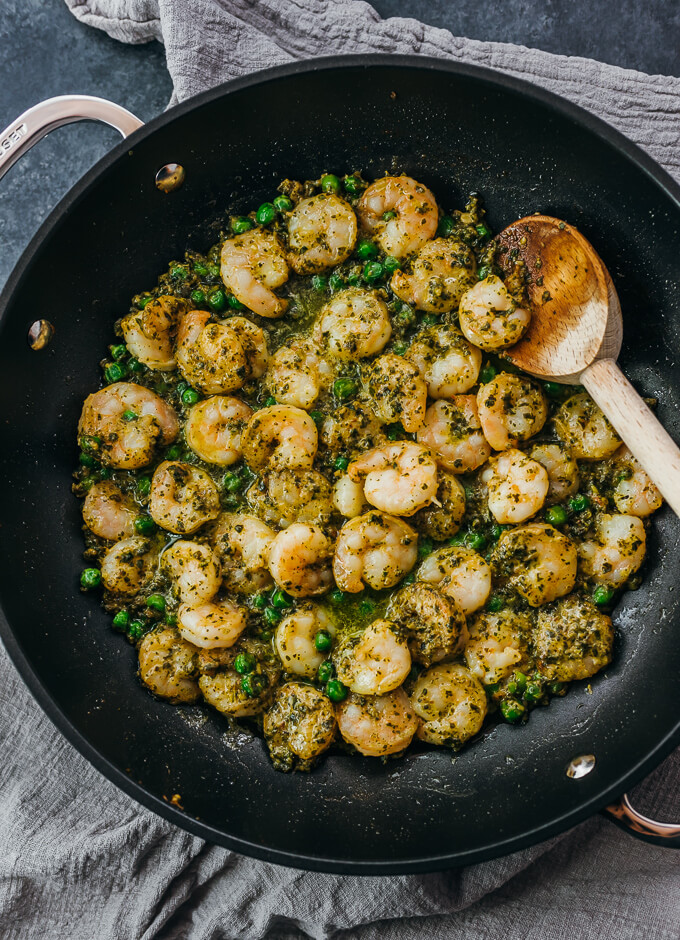 overhead view of pesto shrimp in black skillet