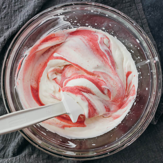 folding raspberry mixture into whipped cream