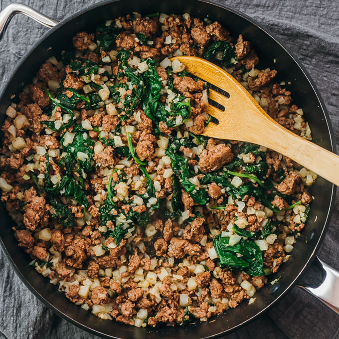 cooking ground lamb with spinach and cauliflower