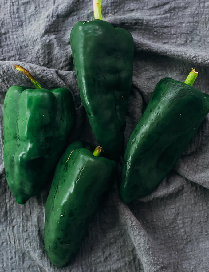 four raw poblano peppers