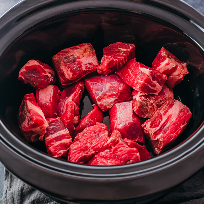 raw beef chunks in slow cooker