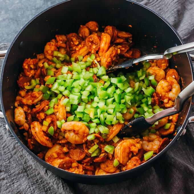 adding bell pepper to jambalaya