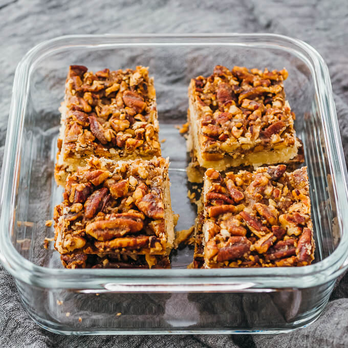 pecan bars stored in glass container