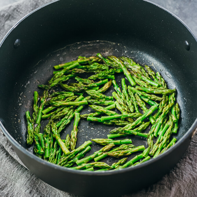 cooking asparagus tips in pot