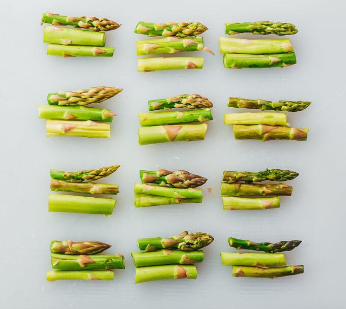 bundles of asparagus on cutting board