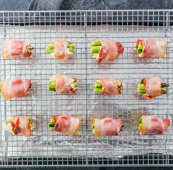 asparagus wrapped in bacon on rack