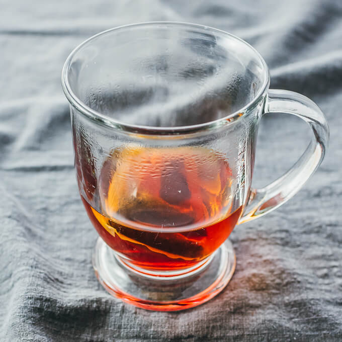 hot tea steeping in glass cup