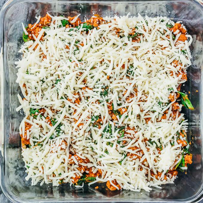 shredded mozzarella cheese in baking dish
